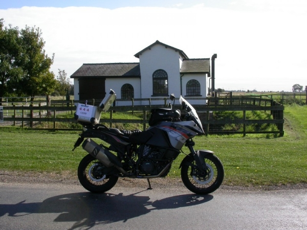 Steve's KTM 1190 Adventure at the Jolly Fisherman Statue at the Gayton Engine Pumping Station